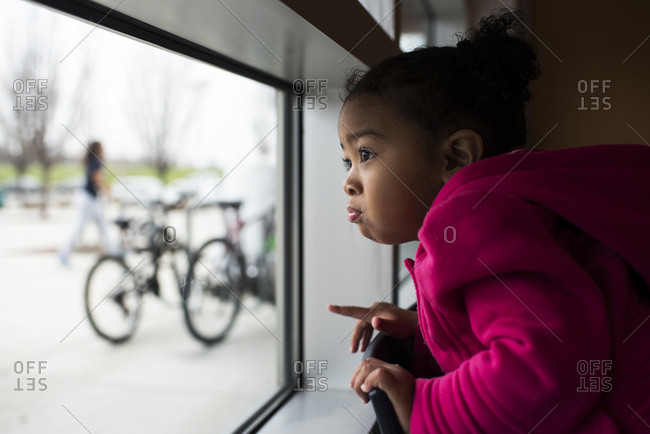 Girl watches at window