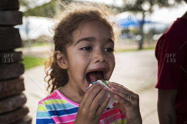 Girl eats a cupcake