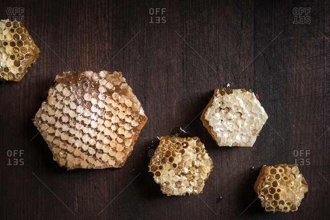 Large pieces of fresh honeycomb cut into hexagon shapes