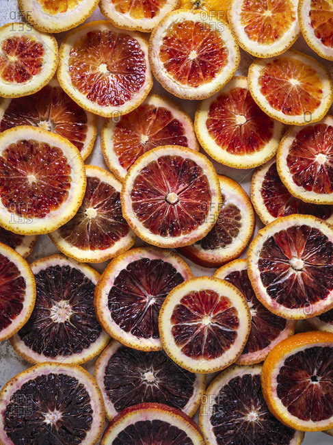 Sliced blood oranges in ombre pattern, full bleed