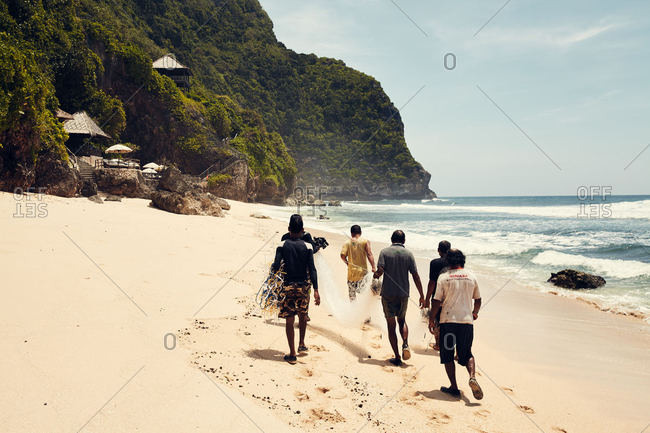 Bali, Indonesia - January 5, 2017: A group of local fishermen on a beach