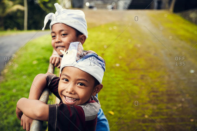 Bali, Indonesia - January 15, 2017: Two smiling boys in hats