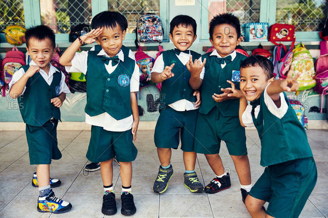 Bali, Indonesia - January 24, 2017: School kids making gestures
