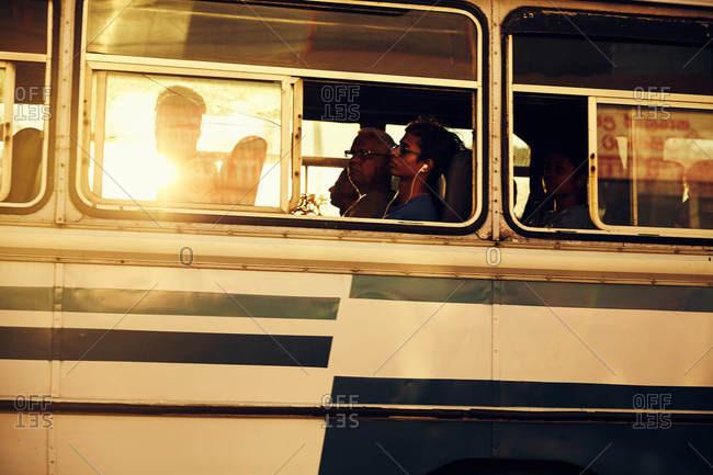 Colombo, Sri Lanka - January 28, 2017: People riding a bus in sunlight