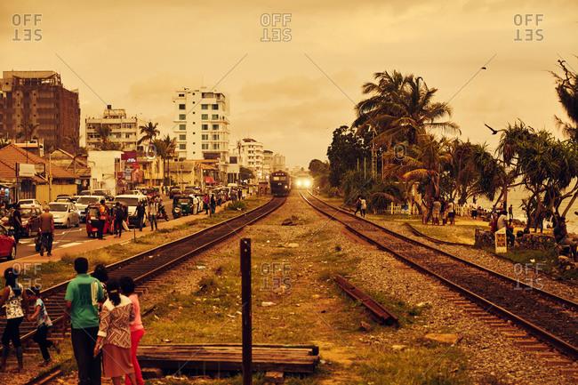 Colombo, Sri Lanka - January 29, 2017: Crowds by train tracks