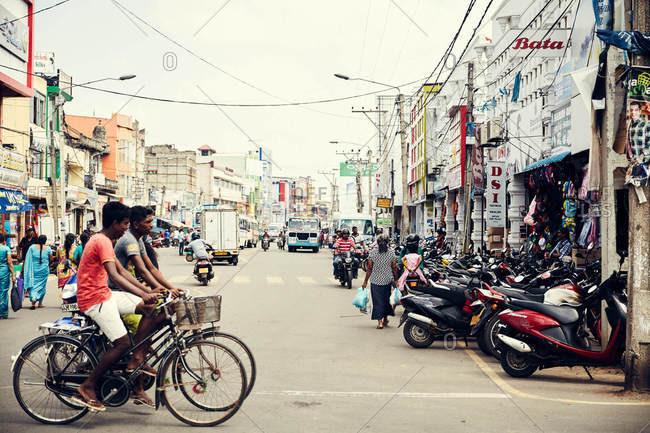 Jaffna, Sri Lanka - February 4, 2017: People riding bikes in traffic