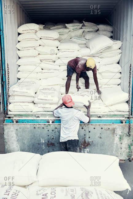 Jaffna, Sri Lanka - February 4, 2017: Men unloading flour from truck
