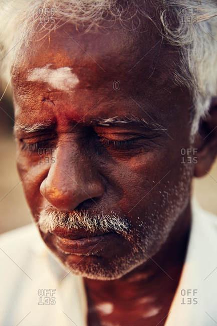 Jaffna, Sri Lanka - February 4, 2017: Old man with paint on forehead