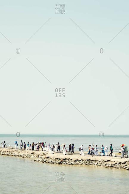 Jaffna, Sri Lanka - February 6, 2017: People walking along causeway