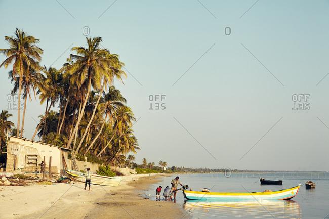 Jaffna, Sri Lanka - February 6, 2017: Fishermen working on their boat