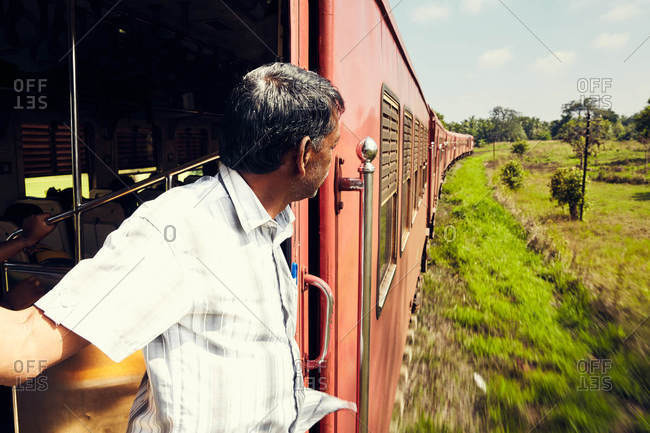Sri Lanka - February 7, 2017: Man watching as he rides train