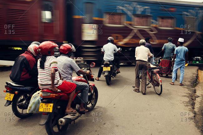 Weligama, Sri Lanka - February 20, 2017: People waiting for train to pass