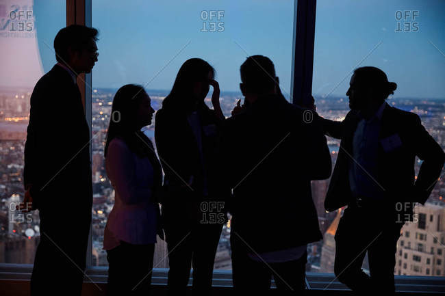 New York City - March 29, 2017: Five people in World Trade Center window