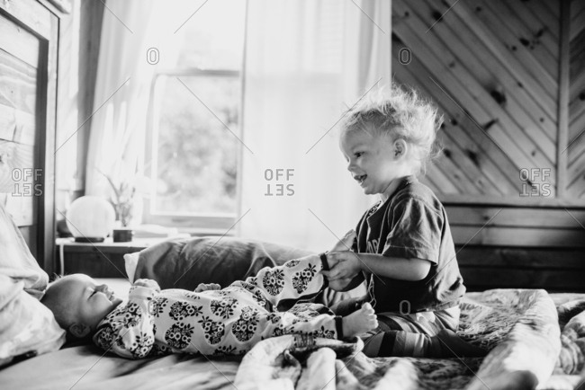 Boy playing with baby brother