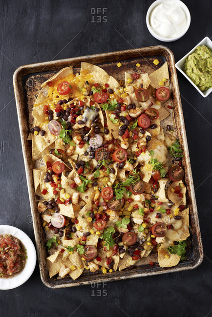 Nachos on a baking sheet