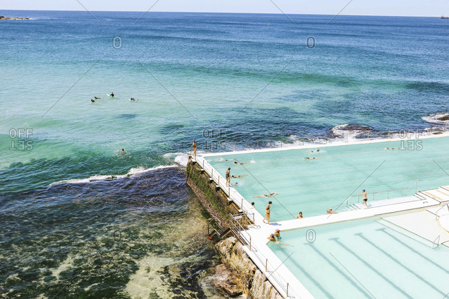 Australia, New South Wales, Bondi Beach - February 20, 2017: High angle view of people enjoying in infinity pool