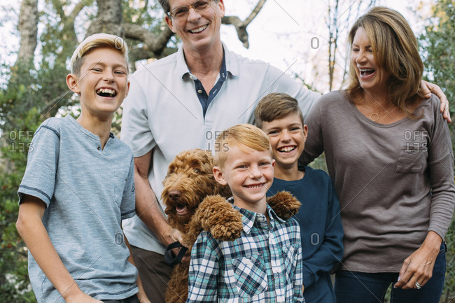 Happy family with Irish Wolfhound at park