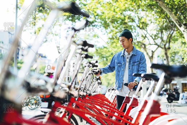 Man renting bicycle on street