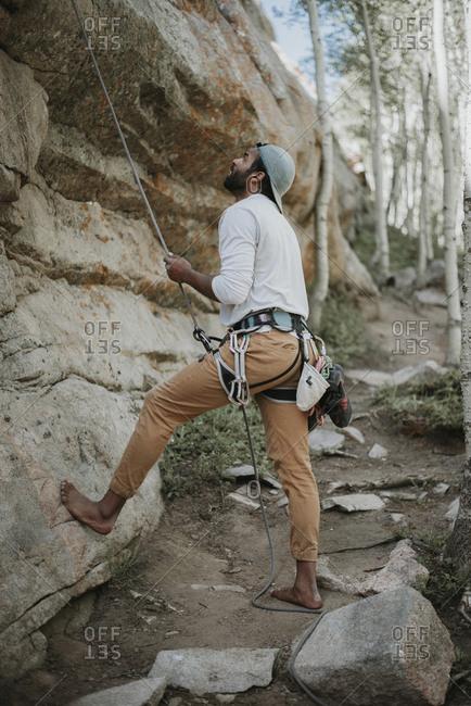 Man looking up before mountain climbing