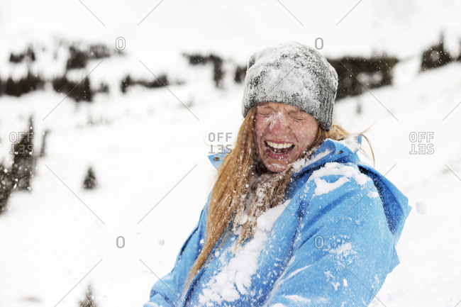Cheerful woman covered with snow