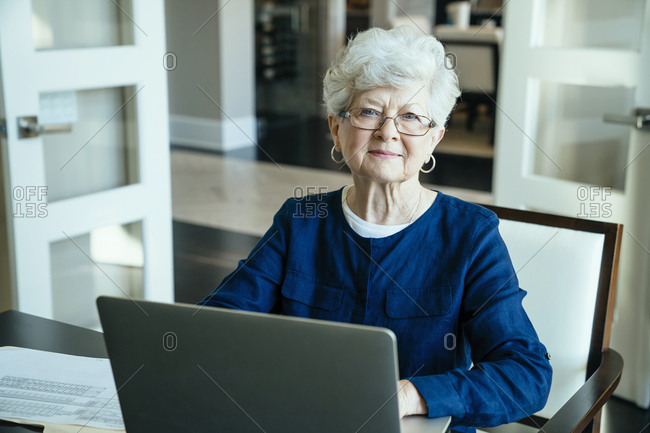 Portrait of senior woman using laptop computer at home