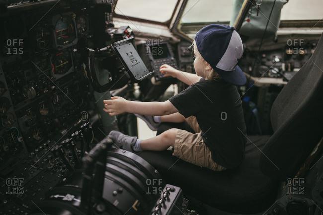 Boy sitting in cockpit