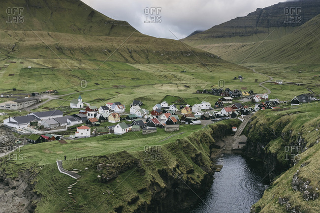 High angle view of village against mountains