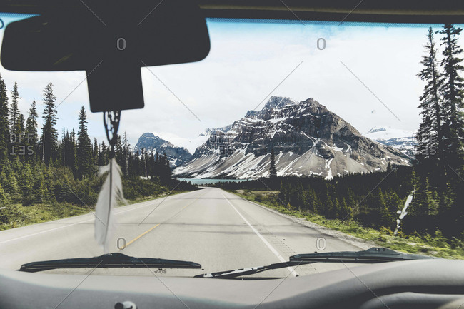 Mountains against clear sky at Jasper National Park seen through car's windshield