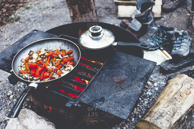 High angle view of food in cooking pan on fire pit at campsite