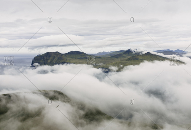 High angle view of mountains amidst clouds