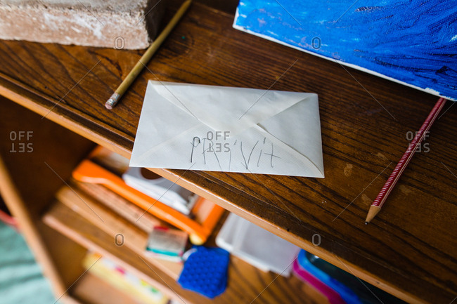 "Envelope labeled ""private"" in child's misspelled handwriting"