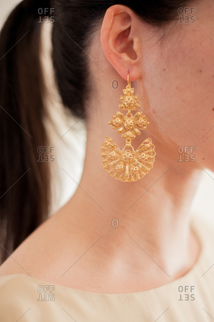 Close up of gold earring on bride