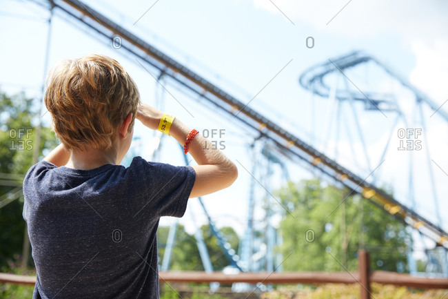 Boy watching a roller coaster