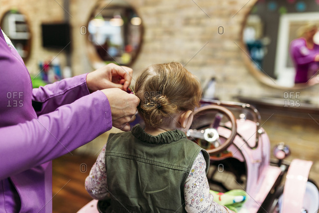 Little girl getting hair done