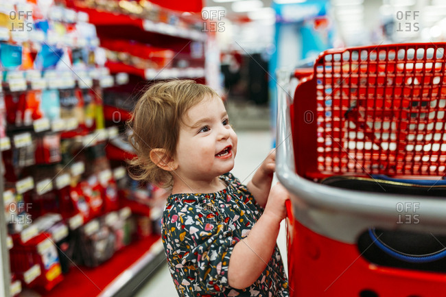 Little girl on a shopping cart