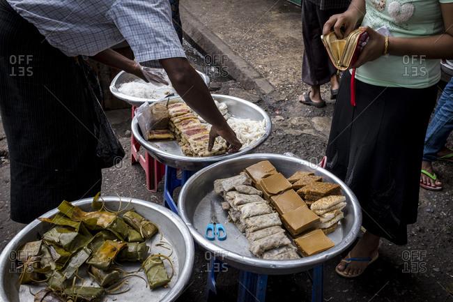 Yangon, Myanmar - September 20, 2016: Selling street food in Burma