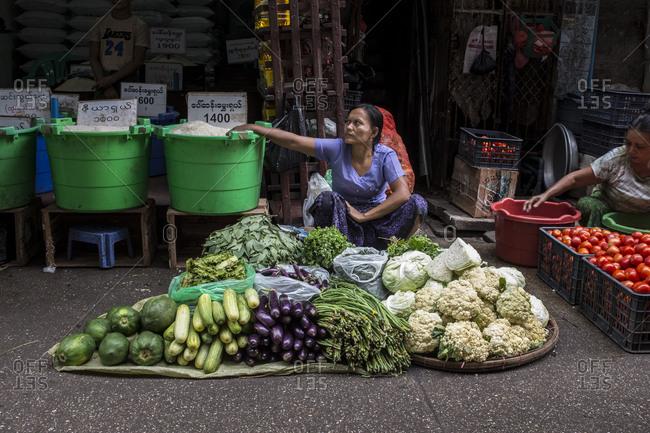 Yangon, Myanmar - September 20, 2016: Women selling vegetables in Myanmar