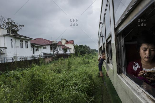 Yangon, Myanmar - September 20, 2016: Woman on phone in train in Myanmar