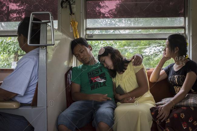 Yangon, Myanmar - September 20, 2016: People sleeping on train in Burma