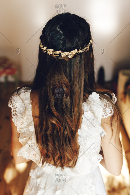 Headband on a curly hair of a bride