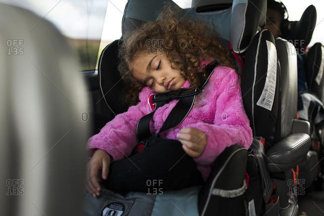 Toddler sleeps in a car seat