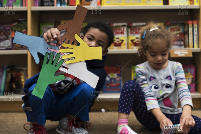 Boy displays paper arts and crafts in bookstore