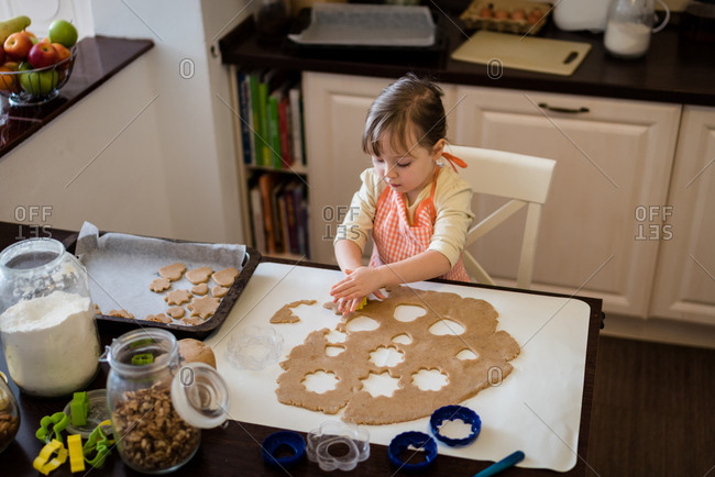 Kid baking cookies in the kitchen. Shot from above.