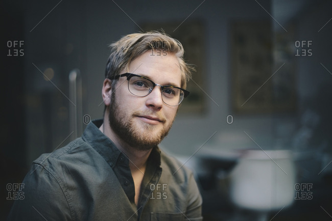 Portrait of confident male computer programmer in office