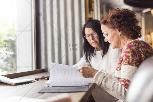 Two senior women going over paperwork
