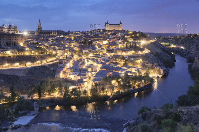 April 19, 2017: View over Tajo River at Santa Maria Cathedral and Alcazar, UNESCO World Heritage Site, Toledo, Castilla-La Mancha, Spain, Europe
