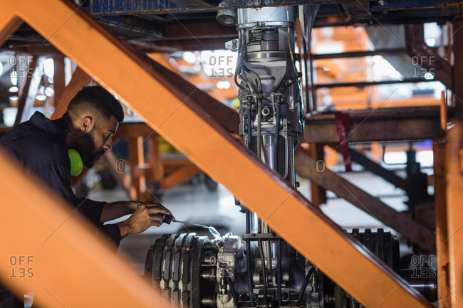 Aircraft maintenance engineer working over chassis of an aircraft at airlines maintenance facility