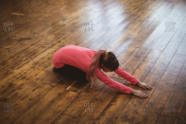 High angle view of woman doing yoga on hardwood floor