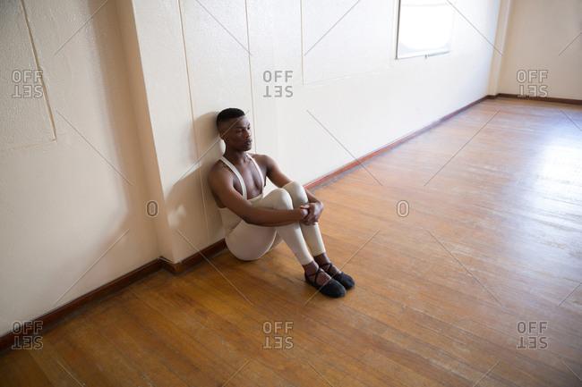 Depressed ballerino sitting in the studio