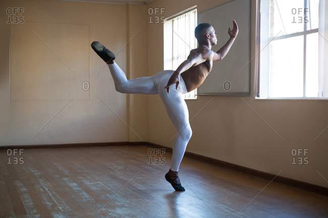 Ballerino practicing ballet dance in the studio